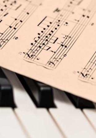 https://www.pexels.com/photo/chords-sheet-on-piano-tiles-210764/